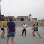 Another group plays volleyball