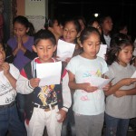 The children sing a song for us after dinner
