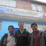 In front of the church with a member and Pastor Juan