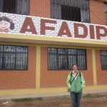 Anne in front of the AFADIPH office
