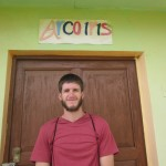 Jordan in front of the Arco Iris School in Chincay