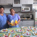 Alicia and daughter Jhanet prepare a sample of exotic fruit for each student