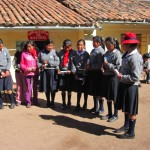 Girls from the school sing a Peruvian highland song