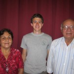 With his host parents, Maru and Lucho