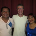 With his host parents, Jose and Carmen