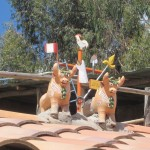 Two bulls and a cross adorn most roofs here in Chinchero