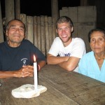 With his host father, Augusto, and mother, Dominga