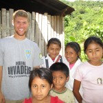 With children outside his home