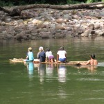 Using a raft to cross the river