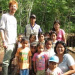 With the main teacher and children in the garden behind the school