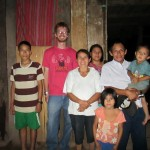 With his host family, Margarita, Julio and their children