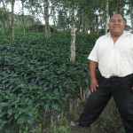 Pastor Alejandro with coffee seedlings