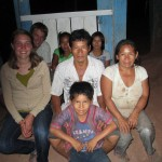 After dinner with their hosts, village president Roberto Boliviano and his family