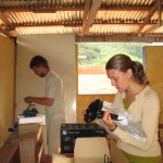 Lucas and Sophie set up a recently-donated computer in the village school