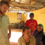 Testing the system with the village president, Roberto Boliviano, looking on