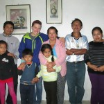 With members of her host family, including her mother Gloria and father Orlando