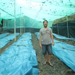 Her host father, Roberto, inside a new greenhouse designed to grow mushrooms