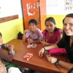 Teaching a new game, Uno, to the children in her class
