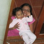 Her aunt, Guadalupe, with baby Maya