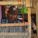 An artisan, Necker, demonstrating his weaving technique