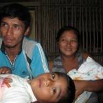 Kevin, a brave patient, with his father, mother and baby brother