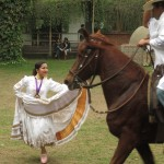 "This version of the ""marinera"" originated on the coast of Peru -- the woman dances with a horse and its rider"