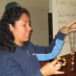 Elliana Carrasco leads a workshop on jewelry making