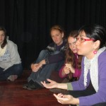 Bivi (right), a professional actress and Spanish instructor, helps the students prepare for the drama at the farewell party