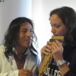 Giving the pan flute (zampona) a try, with a little help from an expert