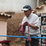 Our guide, Oswaldo, explains the meaning of the symbols in this chuyu (knitted hat)