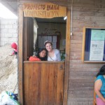 At the door of Project Mana, an after-school program funded by Compassion International