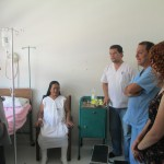 Kristin accompanies the doctor and his staff during a visit with a patient who suffers from diabetes