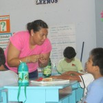 Using Peruvian signs to communicate with the three deaf boys in her class