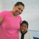 With Victor, a bright boy who cannot hear but enjoys signing with Maritza
