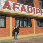 Ana stands outside the headquarters of AFADIPH, a non-governmental organization that supports families who relocated here during the terrorist activity of the 1980s and 90s