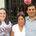 Danae with her host parents, Marcelina and Pastor Heber, outside the used clothing store her mother owns