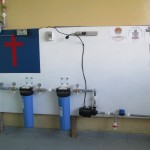A filtering system provides drinking water to the school and the neighbors