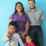 With his host mother, Yovana, and two siblings, Caleb and Anahi