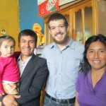 With members of his host family (from left): Anahi, Pastor Juan and Yovana, shortly before they join the funeral procession