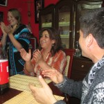 "Singing ""Cumpleanos Feliz"" (Happy Birthday) -- first in English, then Spanish"