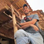 Brian built this ladder from Eucalyptus trunks -- the family uses it to access the new second floor of their adobe house