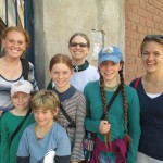 Outside the school with the directors' children and Ms. Marta (center), a North American teacher at the school