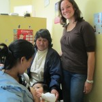 With Margarita, a young patient and his mother in the reception area