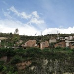 The dirt road behind the hostel in San Sebastian passes through a neighborhood of adobe houses