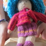 "Sierra knitted this doll for Teresa -- she named her ""Mora"" (Blackberry)"