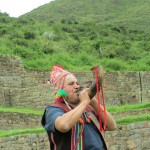 A curandero, or shaman, blows a traditional Andean horn
