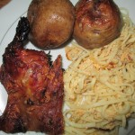 Cuy (guinea pig) with roasted potatoes and baked noodles