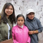 With her host sisters, Nayeli and Cinthia