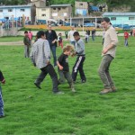 The students are challenged to a game of soccer by youth from the village