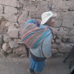 His skirt was traditionally worn by shepherds but is very rare these days.  The manta (blanket) on his back is a common way of carrying anything from potatoes to small children